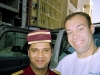 With a Kuwaiti bellhop. If only the hotels in America could employ smiling faces like this. Or at least make their workers wear that hat.